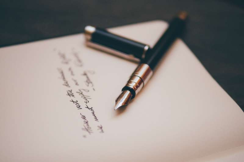 Fountain pen and writing on paper representing translation writing portfolio